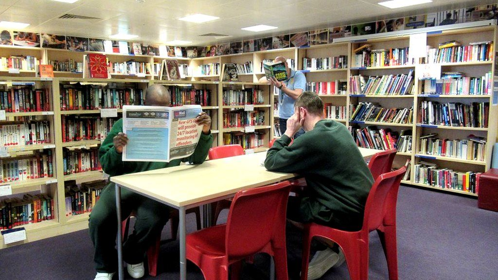 Inmates use the prison library