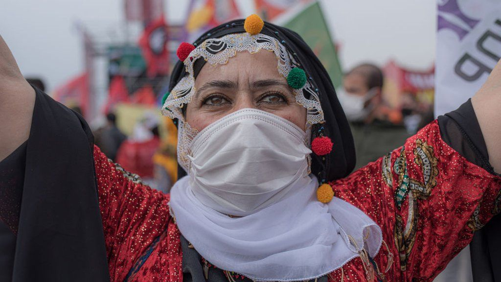 Kurdish woman poses for a photo during the Newroz festival in Istanbul