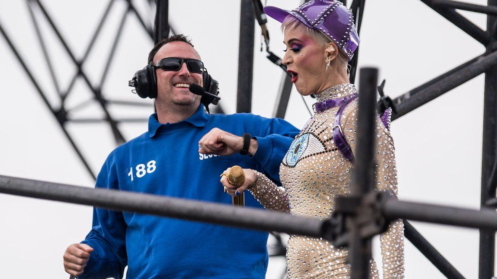 Katy Perry dances with a security guard