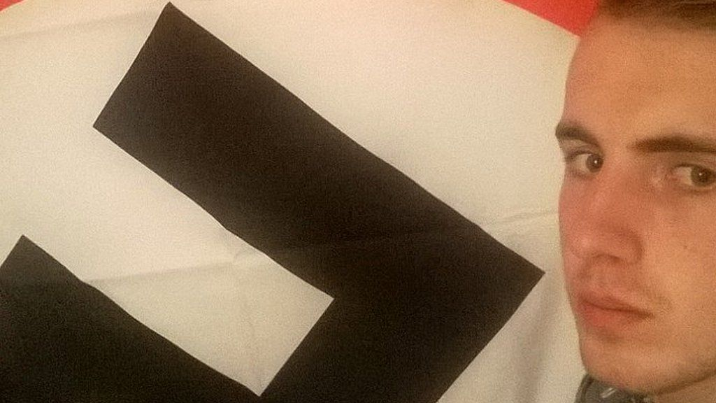Ethan Stables and his prized swastika flag