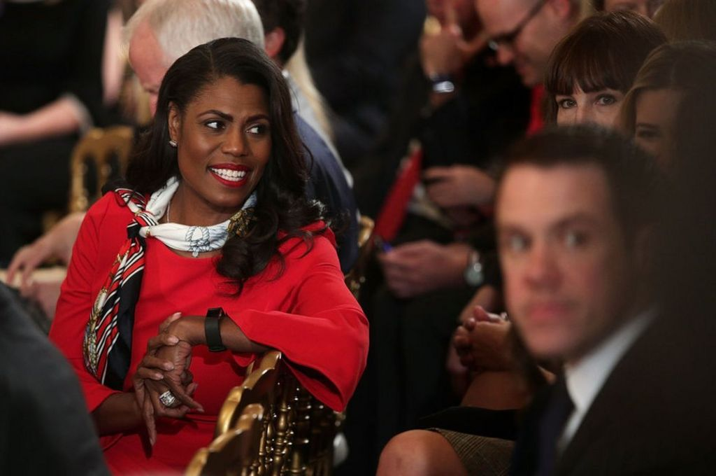 Aide denies being dragged from White House