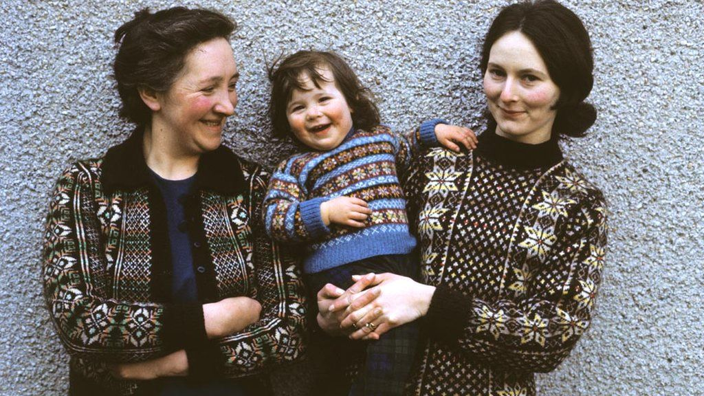 Two women and a young girl pose wearing Fair Isle sweaters in Lerwick, Shetland Islands in 1970.