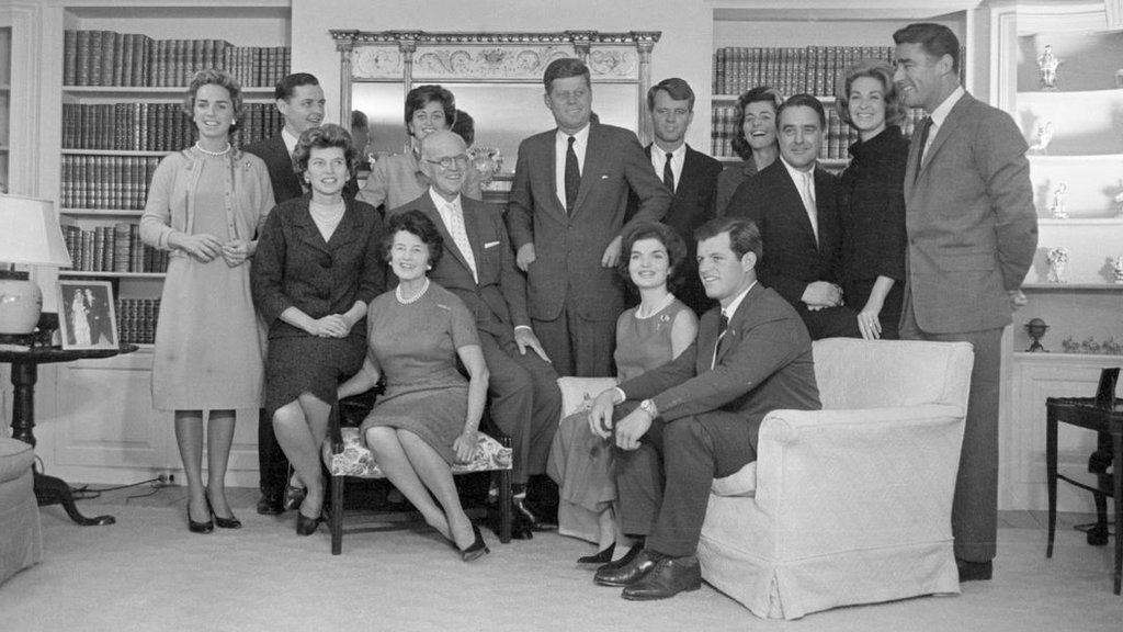 President-elect John F. Kennedy stands at the center of his large family in the living room of his father's home in Hyannisport. Standing by him are: his wife Jacqueline Kennedy; his parents, Joe and Rose Kennedy; brother Robert Kennedy and wife Ethel Ken