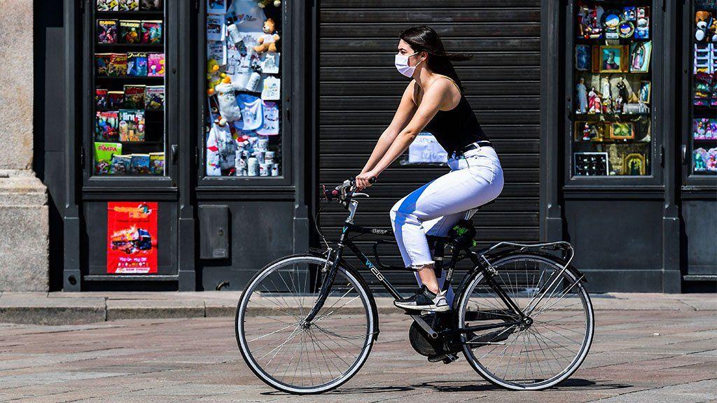 Woman rides a bike in Milan