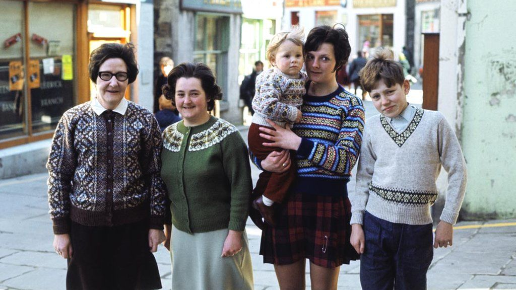 A group of women and children pose wearing a Fair Isle sweaters in Lerwick in 1970.