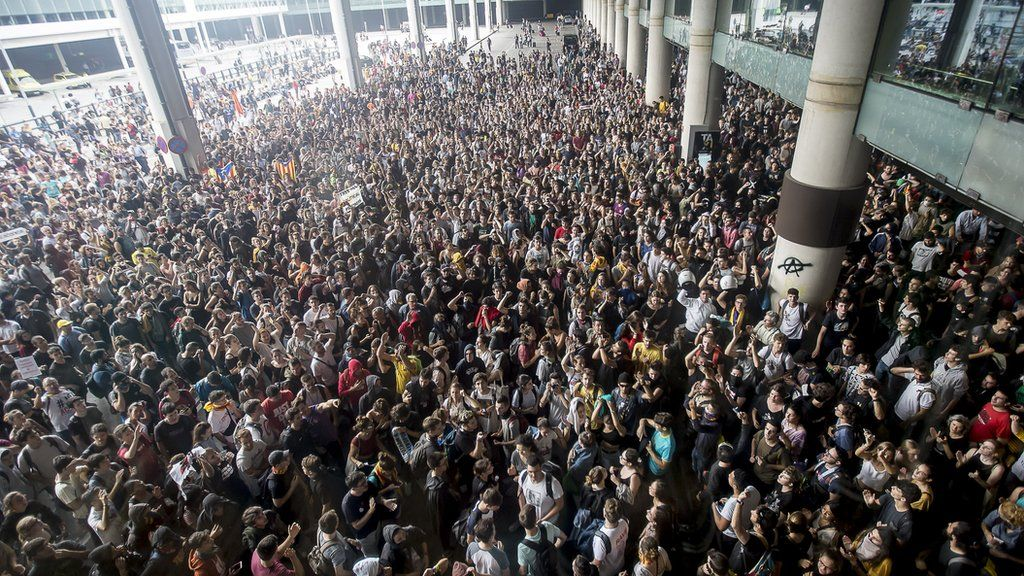 Thousands of Catalonia pro-independence activists occupy Barcelona airport.