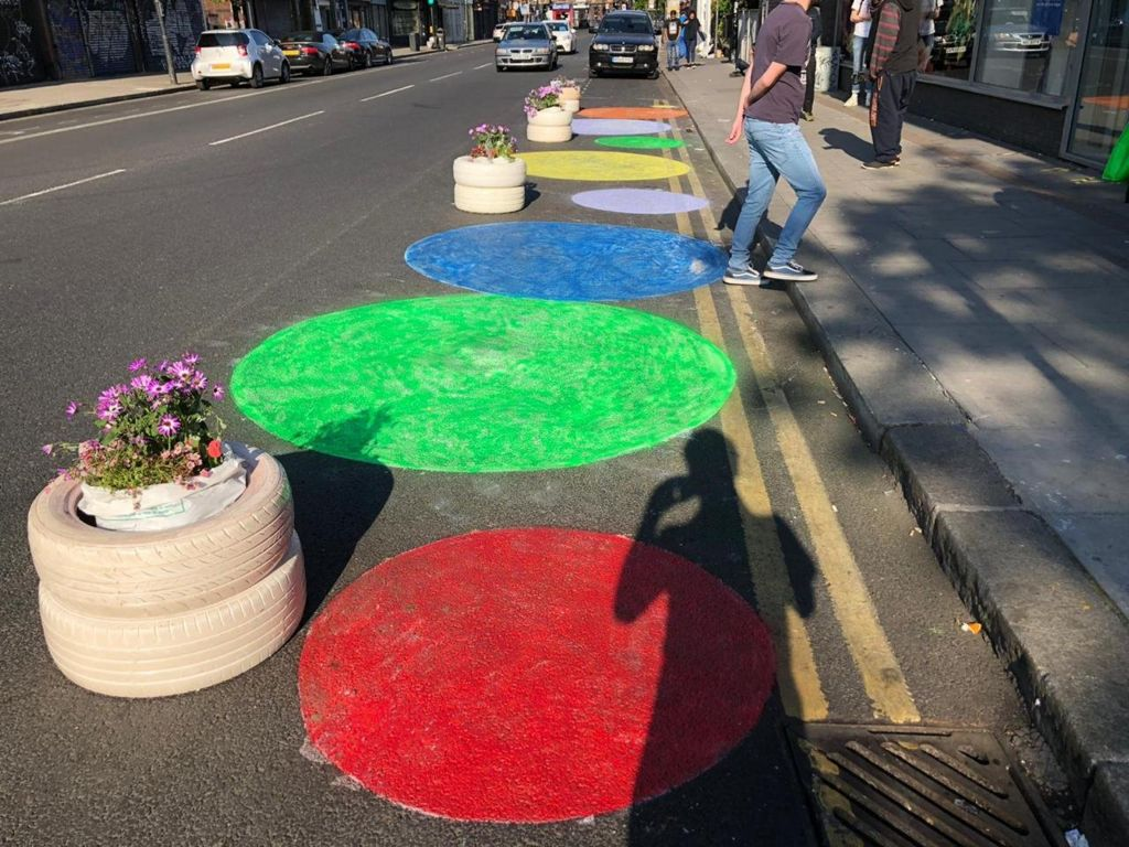 Frustrated at the lack of space to queue, a group of women widened a London pavement themselves