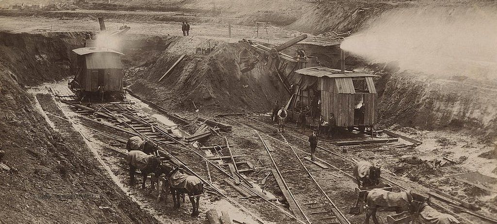 Workers stop for a meal in the cutting at Irlam, Salford, Greater Manchester, during the construction of the Manchester Ship Canal, circa 1890