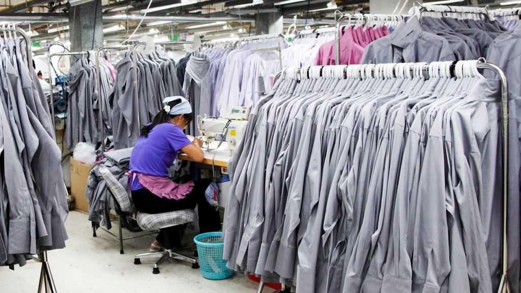 Textile worker in shirt factory