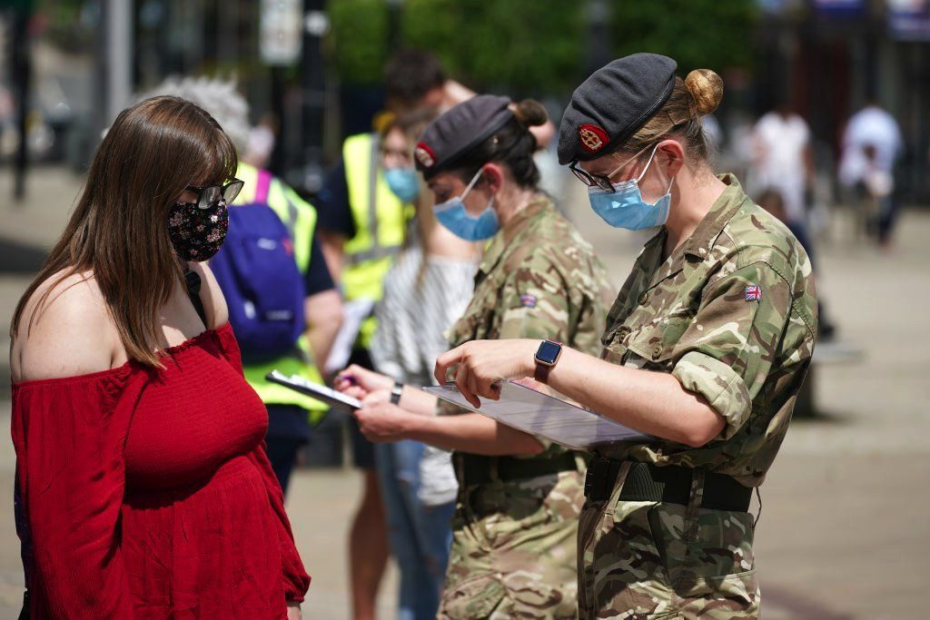 Combat medics from Queen Alexandra's Royal Army Nursing Corps vaccinate members of the public at a rapid vaccination centre