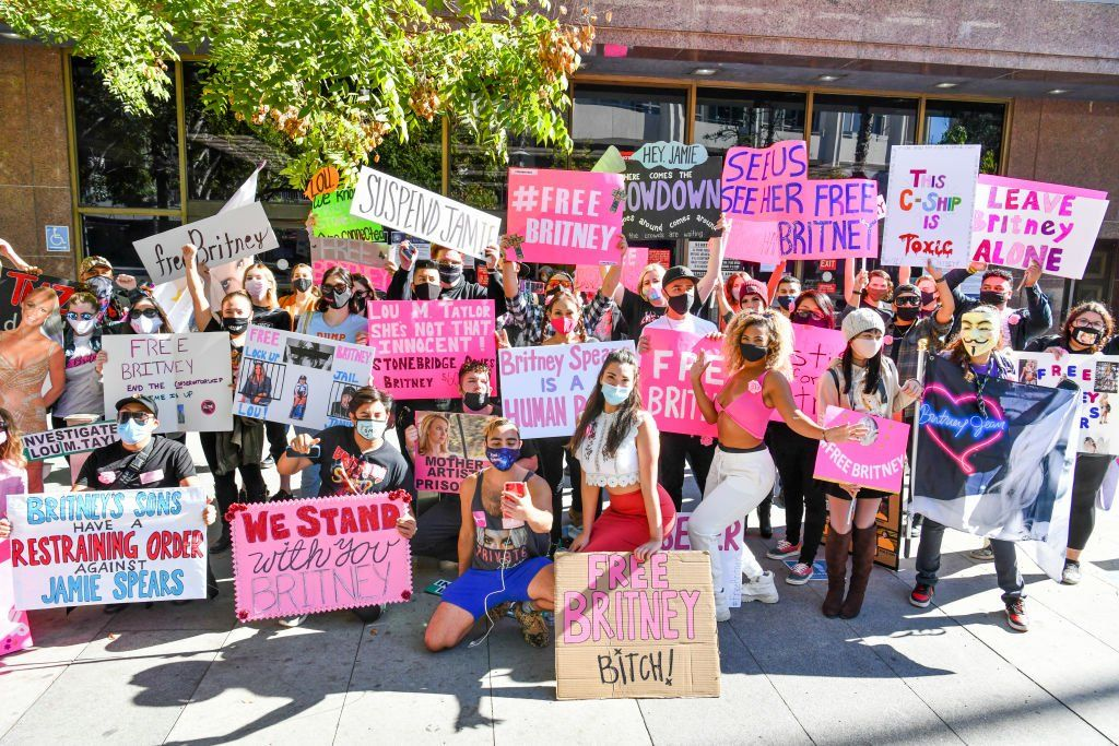 Fans protested outside the hearing