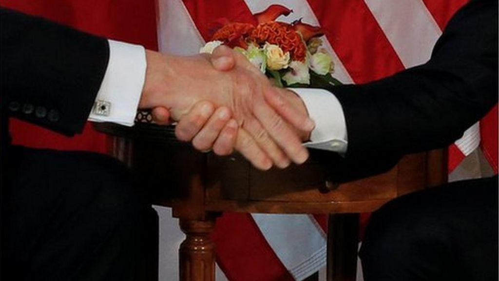 Macron: Awkward Trump handshake a 'moment of truth'
