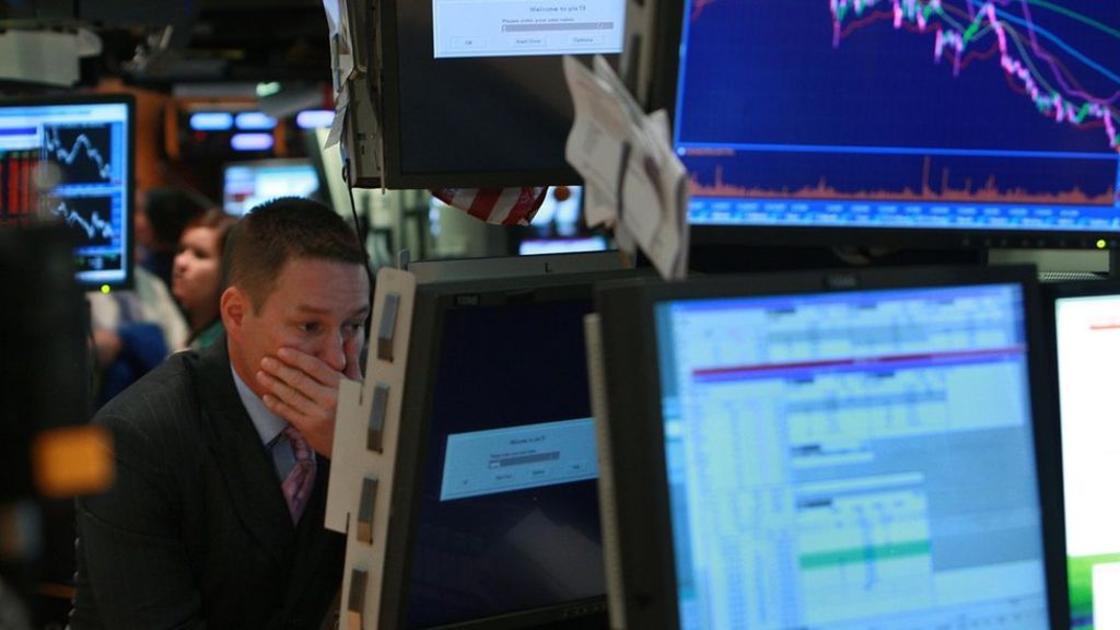 Man in front of computer screens (Credit: Getty Images)