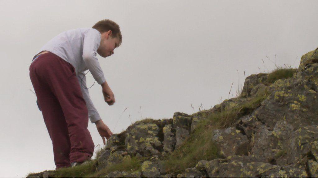 Ethan Loch climbing a hill