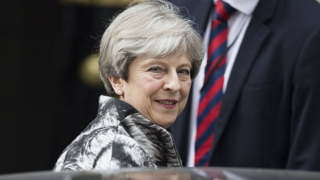 Theresa May tells Conservatives to end 'backbiting'