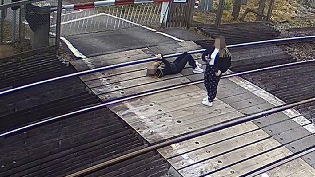 Girl lies on railway line