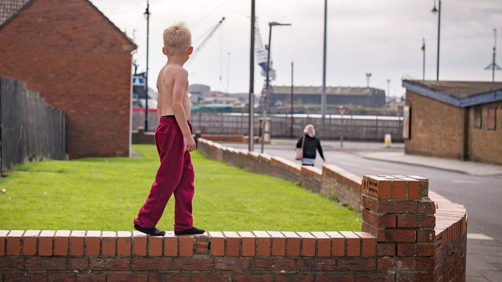 Child on a wall
