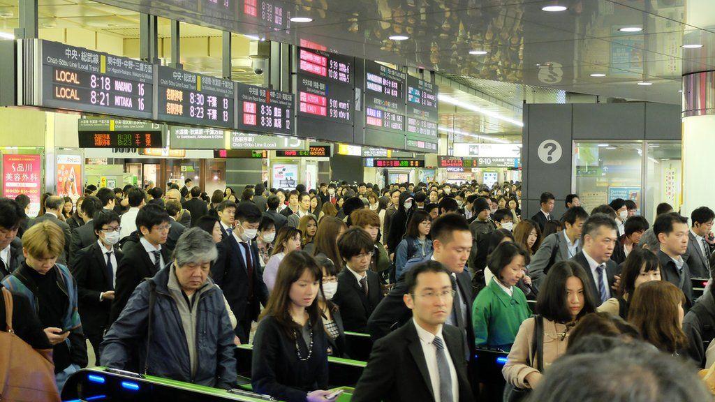 Commuters at Shinjuku station in Tokyo