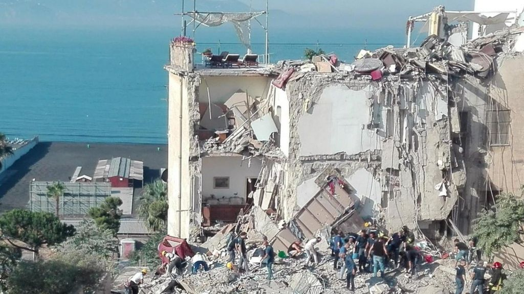 Naples building crumbles – eight missing