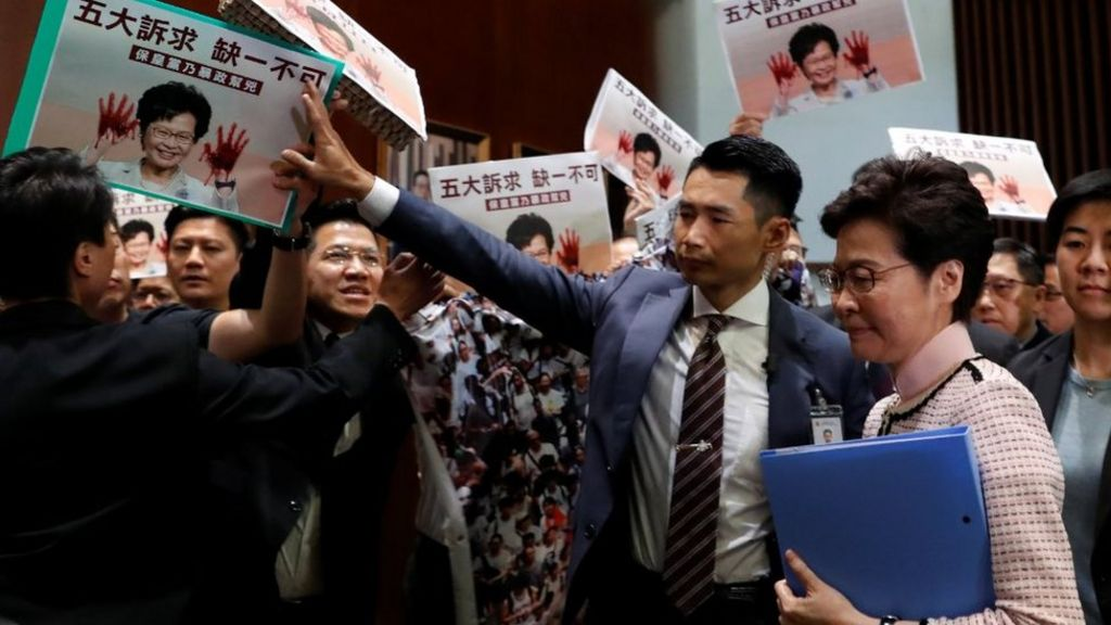 Hong Kong's Carrie Lam abandons speech after protests