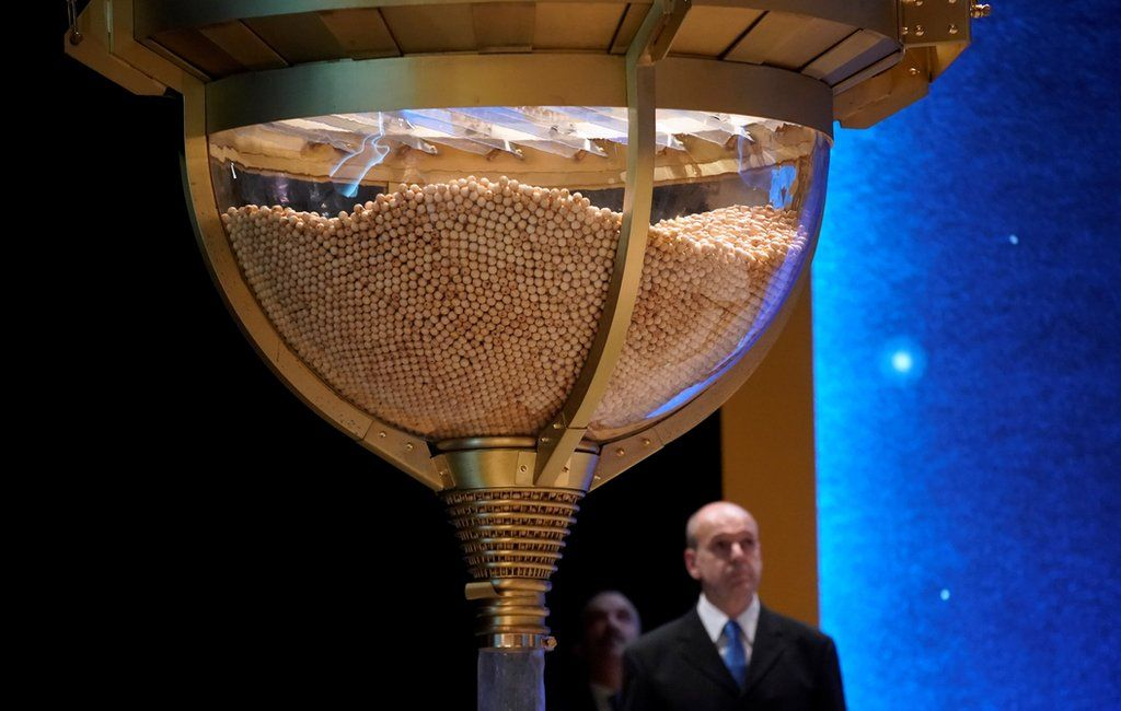 Lottery balls are collected before the start of the Christmas lottery in Madrid.