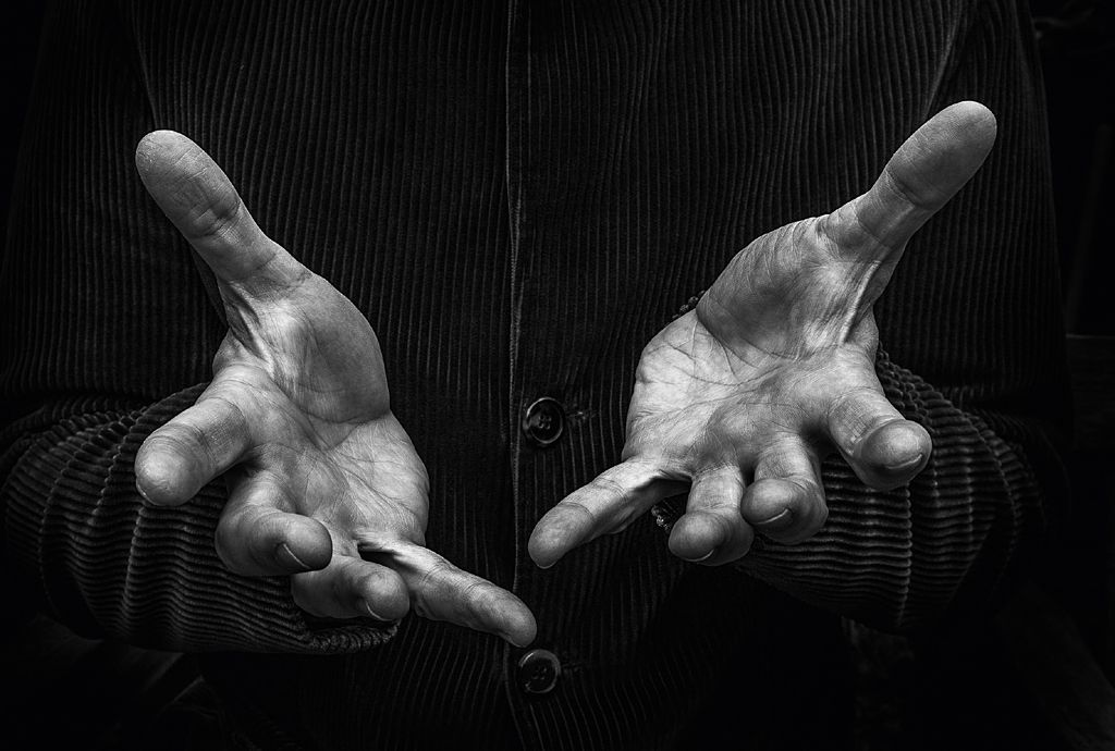 Hands of impressionist Alistair McGowan