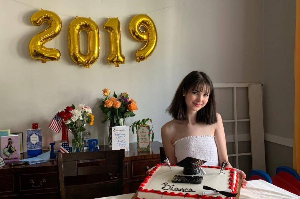 Bianca is seen amongst graduation gifts and next to 2019 balloons