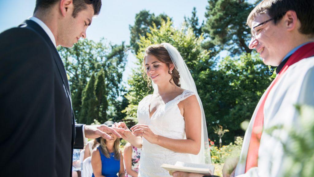 Bride, groom and vicar