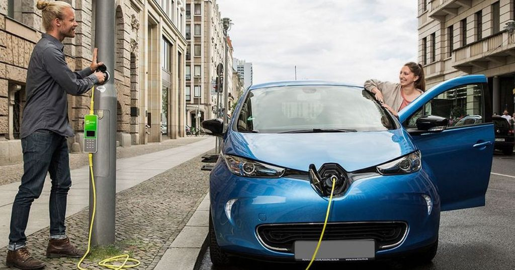 electric car plugged in to lamp-post