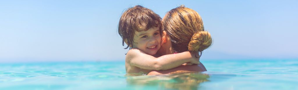 Mother and son in the sea