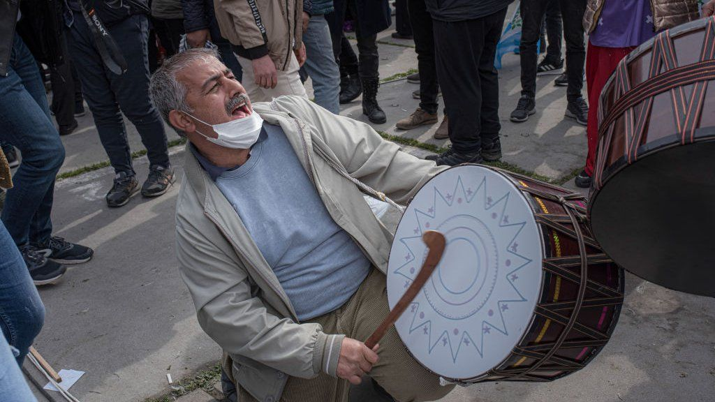 A man seen drumming during the celebration of the Kurdish new year at Istanbul