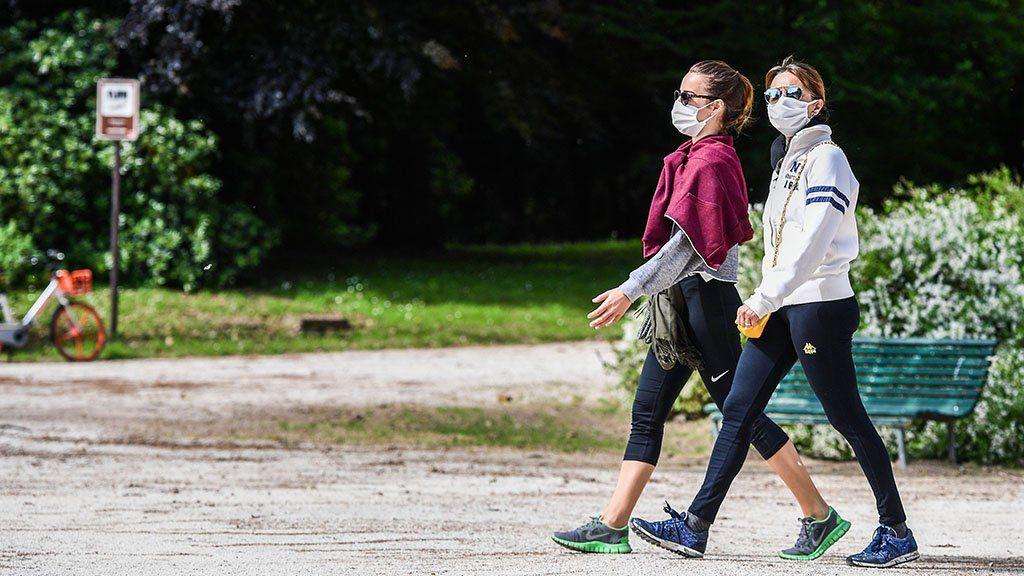 Woman walk in park in Milan