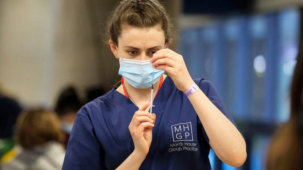 Nurse preparing to vaccinate