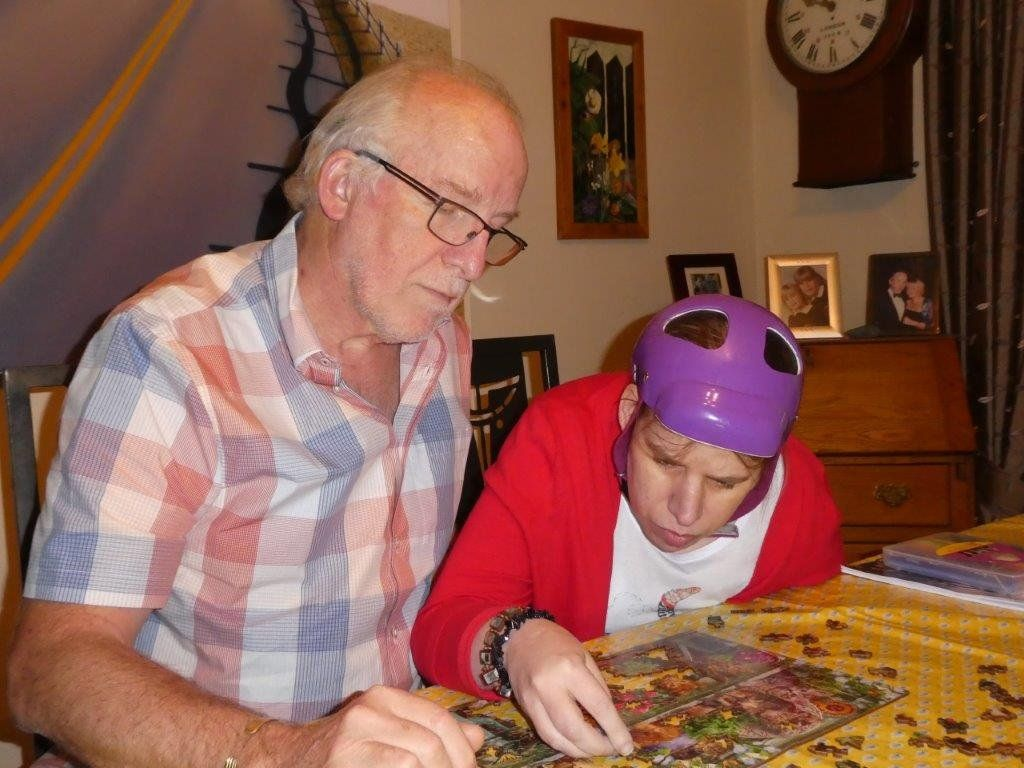 Amy and her father doing a jigsaw