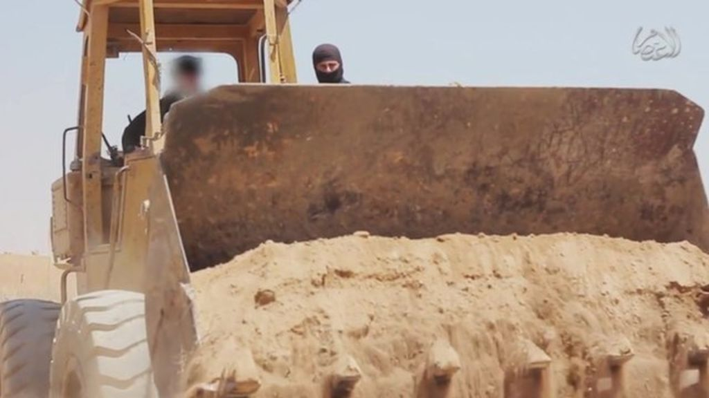 Screengrab of video posted online by IS purportedly showing militants bulldozing the border between Syria and Iraq (2014)
