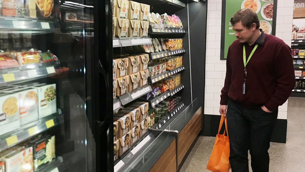 A shopper is seen using his phone in the line-free, Amazon Go store in Seattle, Washington, U.S., January 18, 2018