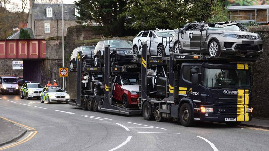Luxury cars crushed as transporter hits low bridge in Perth