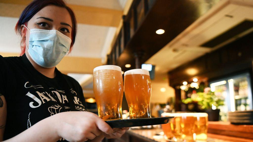 Serving pints in a pub