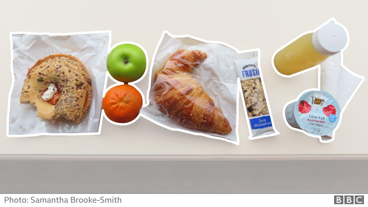 Breakfast - bagel, croissant, yoghurt cereal bar and fruit