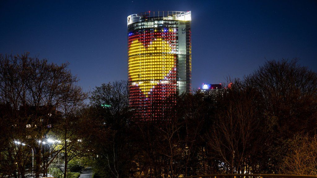 DHL Post Tower illuminated to thank workers during coronavirus crisis. April 5, 2020. Bonn, Germany