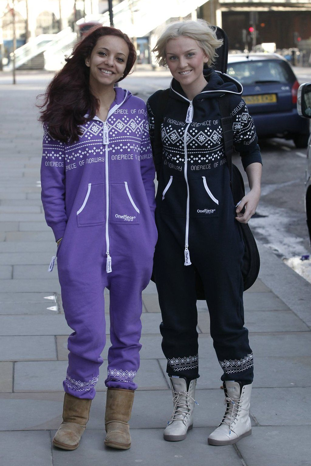 Jade Thirlwall and Perrie Edwards pose outside a hotel in 2011