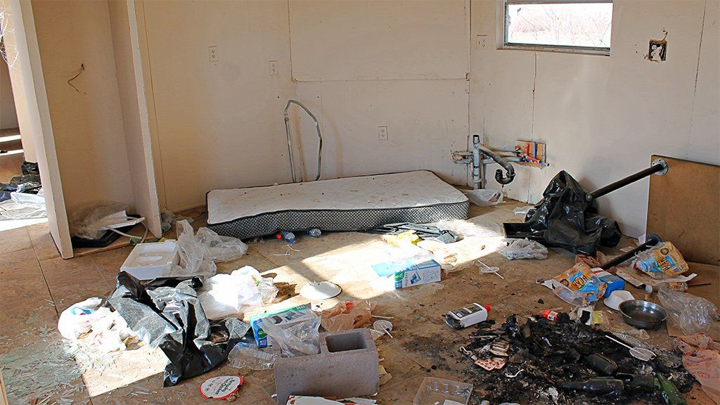 an eerie scene of chaos in a trailer, a naked mattress on the floor