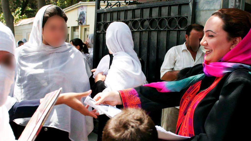 Shukria Barakzai distributing electoral pamphlets to school girls as she campaigns for the parliamentary elections in Kabul, Afghanistan - August 2005