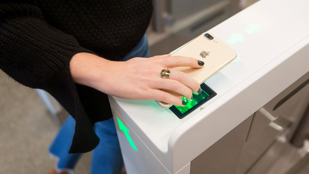 An Amazon employee scans in to shop at the Amazon Go store