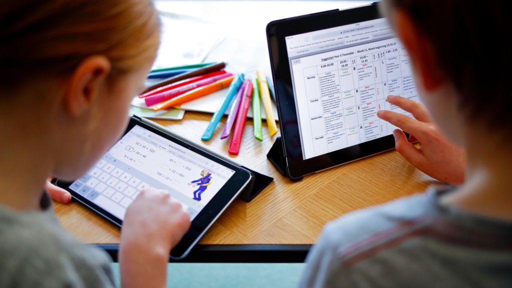 Children using tablets for education