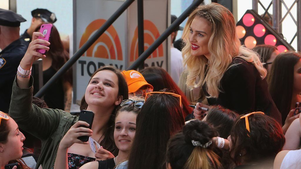 Perrie Edwards poses with fans in America