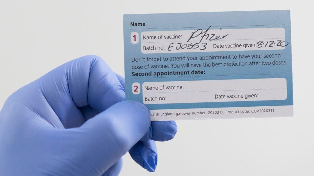 Back of an NHS Covid-jab card