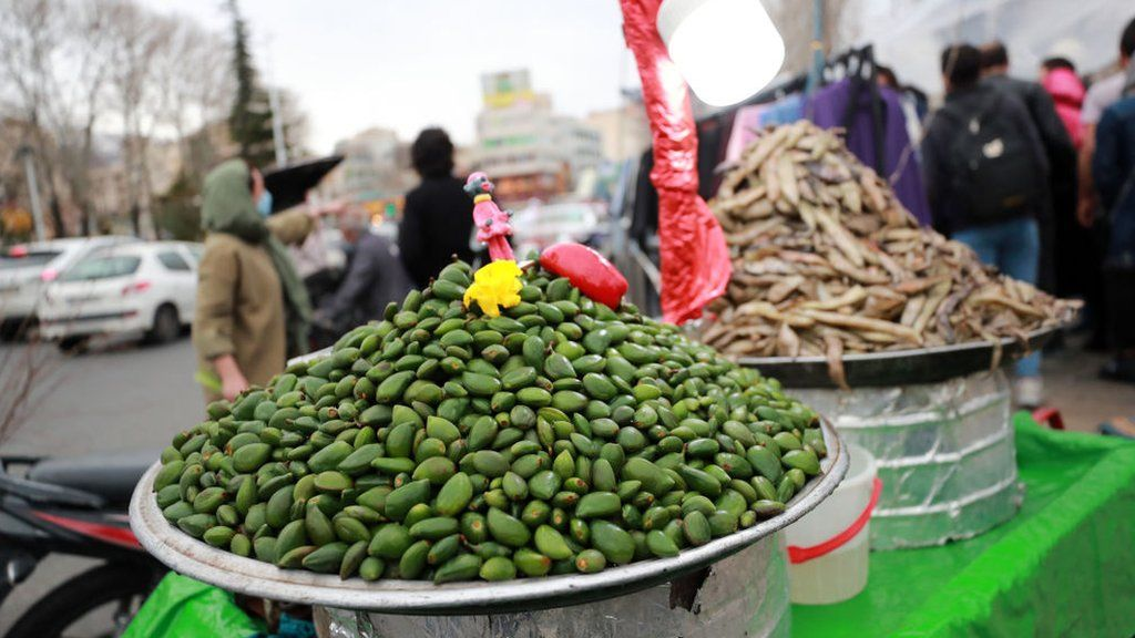 Unripe almonds are displayed for sale as Iranian people get ready for Persian New Year