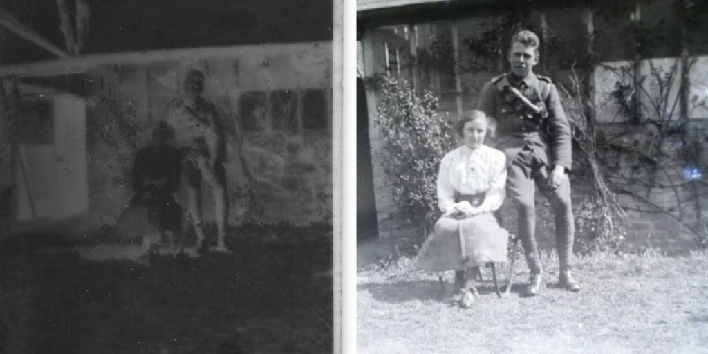 Siblings, or possibly a young couple, pose in a garden
