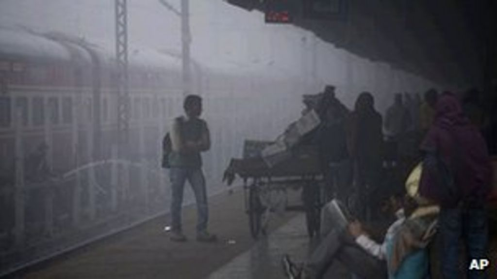 A train at an Indian railway station covered with dense fog on 8 Dec 2011